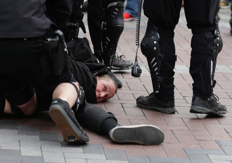 A protester is arrested by Seattle Police during a May Day protest, Monday, May 1, 2017, in Seattle. Thousands of people from New England to the Midwest to the West Coast chanted, picketed and protested Monday as demonstrations raged against President Donald Trump's immigration policies along with the traditional May Day marching in favor of labor. (AP Photo/Ted S. Warren)