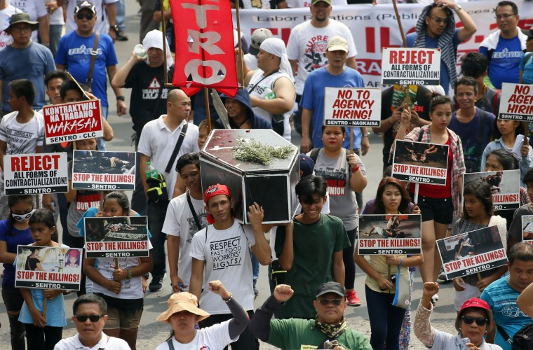 "Protesters carry a mock coffin to protest the continuing killings under Philippine President Rodrigo Duterte's war on drug as they march towards the Presidential Palace to mark May Day celebrations in Manila, Philippines, Monday, May 1, 2017. As in the past years, workers mark Labor Day with calls for higher wages and an end to the so-called ""Endo"" or contractualization. (AP Photo/Bullit Marquez)"