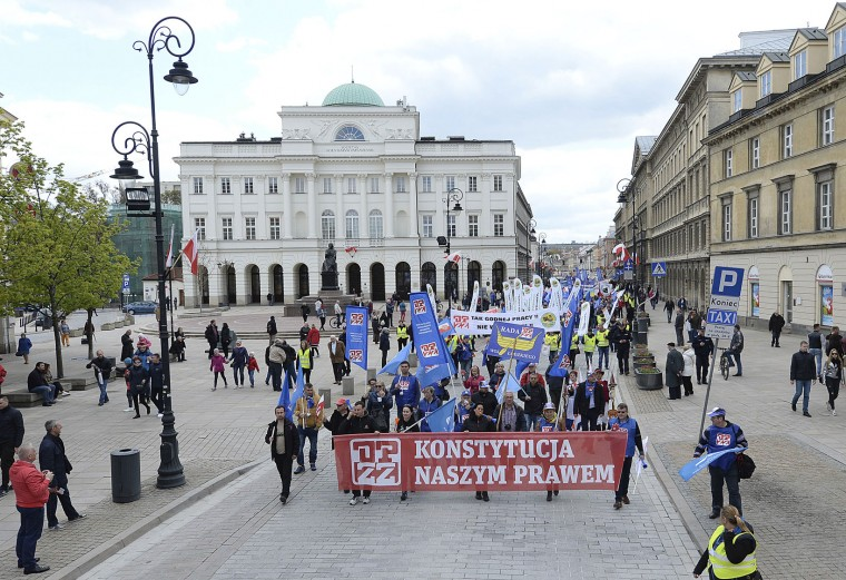 """A few hundred labor union and left wing activists mark May Day, or International Workers Day, with a rally and march calling for the left wing's unity to oppose the policies of the conservative, nationalist government in Warsaw, Poland, Monday, May 1, 2017. Banner in front reads: """"Constitution is our law"""". (AP Photo/Czarek Sokolowski)"""
