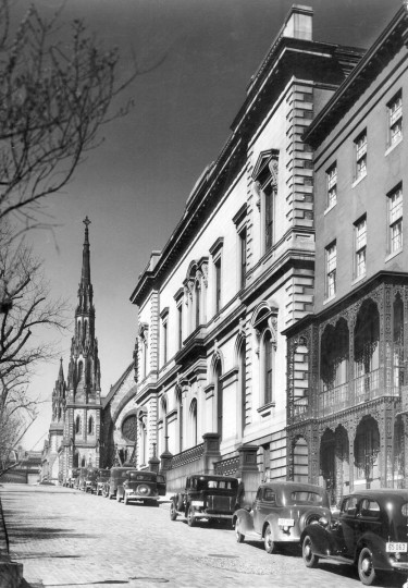 In 1938, cars are seen parked along Charles Street from Centre Street in Mount Vernon. The Mount Vernon Place United Methodist Church, seen in the background, dates to 1872 and is on the National Register of Historic Places. (Aubrey Bodine, Baltimore Sun, 1938)
