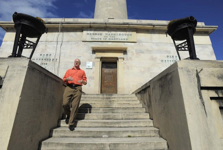 Historian Lance Humphries, chairman of the Mount Vernon Place Conservancy restoration committee is pictured at the monument on Oct. 14, 2013. The Washington Monument will turn 200 years old in 2015, and in advance of its birthday, the obelisk will undergo $5 million in renovations. (Lloyd Fox / Baltimore Sun)