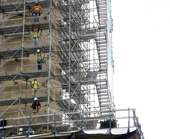 Workers from Lewis Contractors take down the scaffolding around Baltimore's Washington Monument. Mount Vernon Place Conservancy has been working on a complete restoration of the monument that started last January. The scaffolding is scheduled to be down by Halloween with the entire project finishing up by May for the 200th Celebration. (Cassidy Johnson/Baltimore Sun)