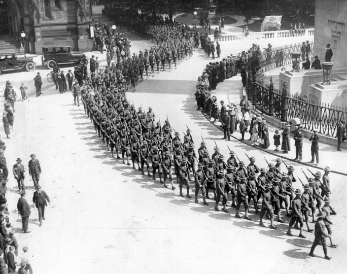 "An Armistice Day parade marches smartly by the Washington Monument in Mount Vernon Place on November 11, 1918, marking the end of the ""war to end all wars."" (Photographer unknown/Baltimore Sun file)"
