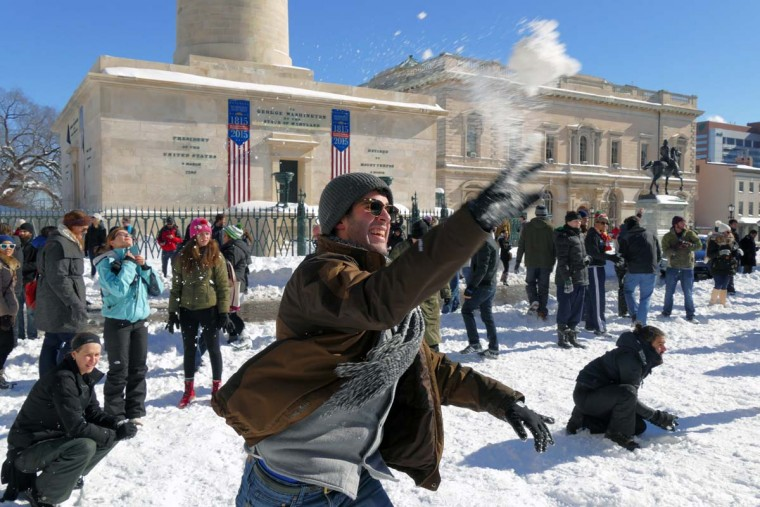 Hundreds of people participate in a snowball war at the base of Baltimore's Washington Monument in Mount Vernon on the first day since a powerful nor'easter snowstorm hammered the east coast on Jan. 24, 2016. (Karl Merton Ferron/Baltimore Sun)
