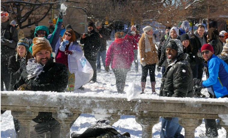 Hundreds of people participate in a snowball war at the base of Baltimore's Washington Monument in Mount Vernon on Jan. 24, 2016. (Karl Merton Ferron/Baltimore Sun)