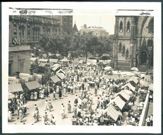 Sunshine and flowers -- The two indispensable ingredients for the Flower Mart on May 14, 1953 drew an estimated 20,000 people to Mount Vernon place, where the Women's Civic League held its annual fair. This view, looking north, shows crowd at noon peak. (Photo by George H. Cook)