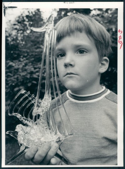 Craig Hassell admires glass ship by Bill Wagner at the Towsontown Festival of 1972.