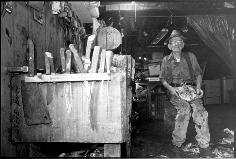 Paul Corun, former owner of Paul's Market on Main Street in Ellicott City, MD., he sold rabbits, chickens, racoons, muskrats and other animals -- live and fresh killed. He is shown in his cellar with the butcher block from the market which he worked in and then owned for a total of 45 years. Mandatory Credit Photo by Peggy Fox. (Photo scanned 03/19/2001) Handout Photo