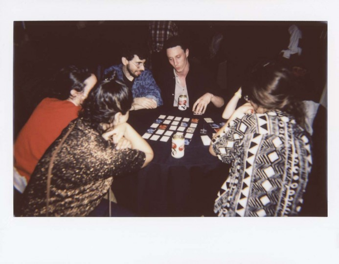 """Theo Anthony, director of """"Rat Film,"""" gaming with other filmmakers at the after-party at Lord Baltimore."""