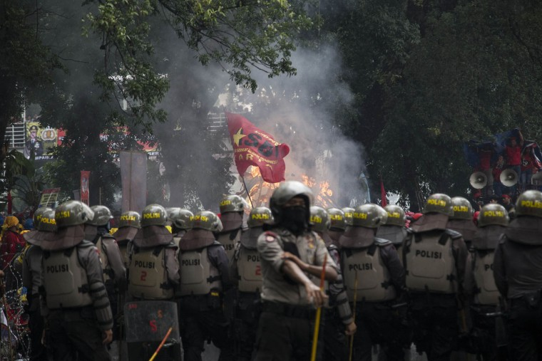 Police stand guard as thousands of labor activists hold a demonstration on May Day Monday, May 1, 2017 in Jakarta, Indonesia. (Donal Husni/Zuma Press/TNS)