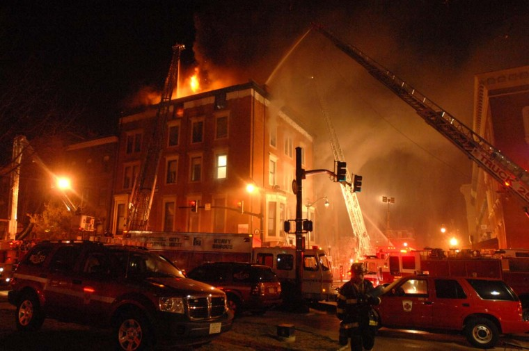 Baltimore firefighters work on a multiple-alarm dwelling fire on Charles Street in Mount Vernon in Baltimore on December 7, 2010. (Jerry Jackson/Baltimore Sun)
