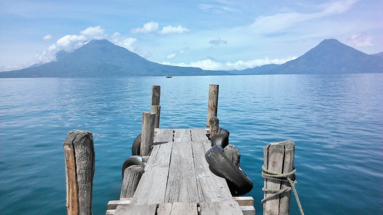 "Great shots don't require a fancy camera; Baltimore Sun reader Randy Holter snapped this frame of Guatemala's Lake Atitlan with his HTC Android phone. Baltimore Sun photo editor Jerry Jackson comments, ""This is a beautifully evocative image to commemorate a special family trip. The sharp focus of the worn pier adds a sense of depth against the monochromatic blue of the twin volcanos, lake and sky."""