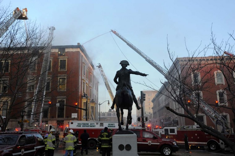 Firefighters continue to work a five-alarm fire in Mount Vernon that heavily damaged two buildings facing Mount Vernon Place on Dec. 7, 2010. (Baltimore Sun photo by Kim Hairston)