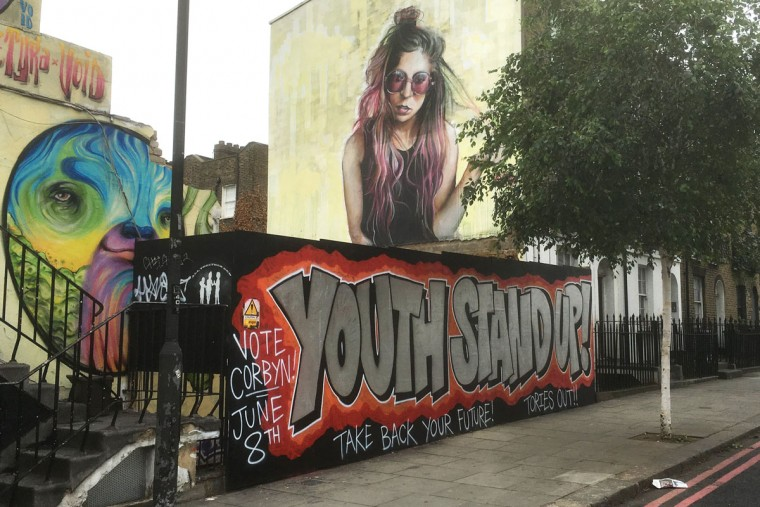 LONDON, UNITED KINGDOM - JUNE 08: A Graffiti piece in support of Jeremy Corbyn is painted on a hoarding board in Camden Town on June 8, 2017 in London, United Kingdom. Polling stations have opened as the nation votes to decide the next UK government in a general election. (Photo by Jim Dyson/Getty Images)