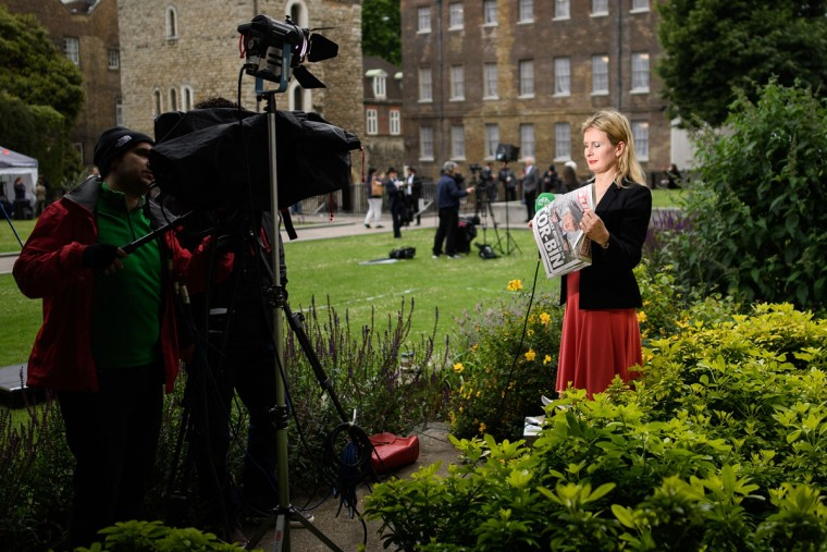 LONDON, UNITED KINGDOM - JUNE 08: An international news reporter holds a copy of The Sun newspaper as she talks about the election on June 8, 2017 in London, United Kingdom. Polling stations have opened as the nation votes to decide the next UK government in a general election. (Photo by Leon Neal/Getty Images)