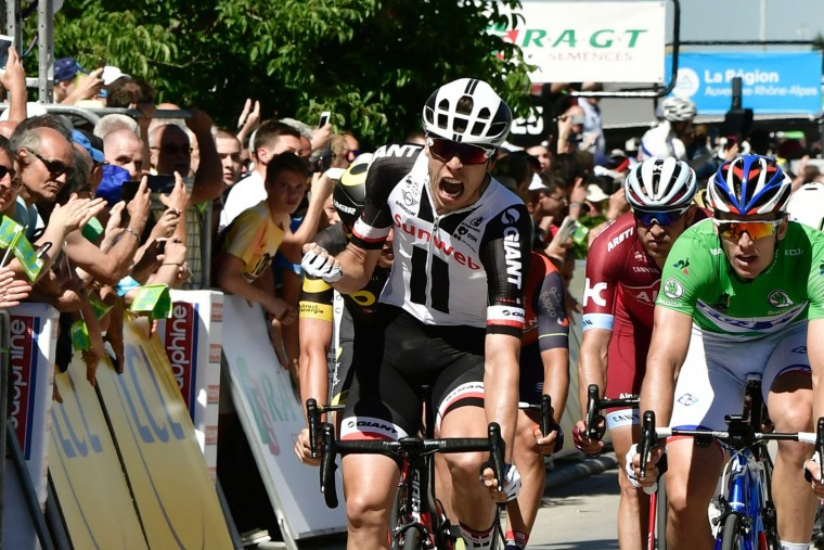Germany's Phil Bauhaus (L) celebrates as he crosses the finish line ahead of Norway's Alexander Kristoff (2ndR), and France's Arnaud Demare (R), wearing the best sprinter's green jersey, at the end of the 175,5 km fifth stage of the 69th edition of the Criterium du Dauphine cycling race on June 8, 2017 between La Tour-de-Salvagny and Macon. (Philippe Lopze/AFP/Getty Images)