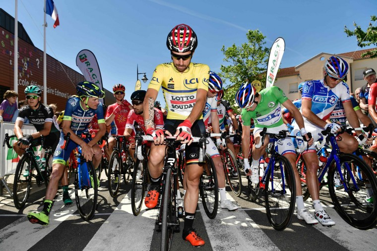 Belgium's Thomas De Gendt, wearing the overall leader's yellow jersey, waits for the start of the 175,5 km fifth stage of the 69th edition of the Criterium du Dauphine cycling race on June 8, 2017 between La Tour-de-Salvagny and Macon. (Philippe Lopze/AFP/Getty Images)