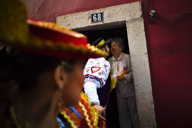 A man dressed up in traditional costume kisses a woman in the traditional Lisbon neighborhood of Alfama before leaving to participate in the Santo Antonio de Lisboa's Parade on Avenida da Liberdade, in Lisbon on June 12, 2017. Lisbon celebrates Saint Anthony's day, the city's protector saint, with a parade that gathers participants from several typical neighborhoods of the city. (Patricia de Melo Moreira/AFP/Getty Images)