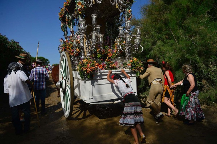 A pilgrim pushes the Simpecao after crossing the Quema river during the annual El Rocio pilgrimage in Villamanrique, near Sevilla on June 1, 2017. (CRISTINA QUICLER/AFP/Getty Images)