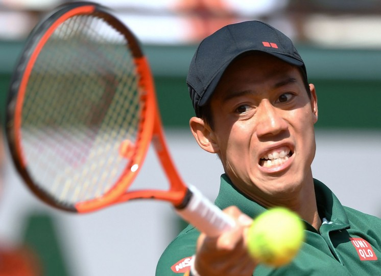 Japan's Kei Nishikori returns the ball to Britain's Andy Murray during their tennis match at the Roland Garros 2017 French Open on June 7, 2017 in Paris. (Francois Xavier Marit/AFP/Getty Images)