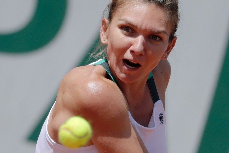 Romania's Simona Halep returns the ball to Ukraine's Elina Svitolina during their tennis match at the Roland Garros 2017 French Open on June 7, 2017 in Paris. (Thomas Samson/AFP/Getty Images)