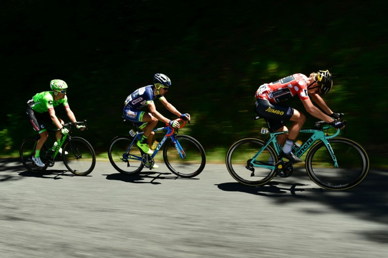 (From R) Netherlands' Koen Bouwman, wearing the best climber's polka dot jersey, Netherlands' Marco Minnaard and Netherlands' Dylan van Baarle ride in a breakaway during the 175,5 km fifth stage of the 69th edition of the Criterium du Dauphine cycling race on June 8, 2017 between La Tour-de-Salvagny and Macon. (Philippe Lopze/AFP/Getty Images)
