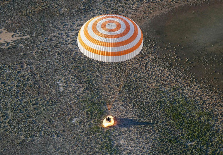 The Soyuz MS-03 space capsule carrying the International Space Station (ISS) crew of Russian cosmonaut Oleg Novitskiy and French astronaut Thomas Pesquet lands in a remote area outside the town of Dzhezkazgan (Zhezkazgan), Kazakhstan, on June 2, 2017. (Pool/Shamil Zhumatov/AFP/Getty Images)