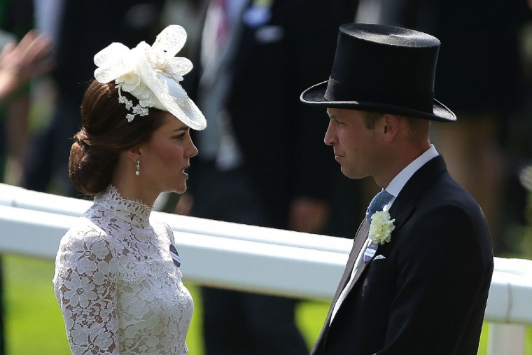 Britain's Catherine, Duchess of Cambridge (L) and Britain's Prince William, Duke of Cambridge, attend day one of the Royal Ascot horse racing meet, in Ascot, west of London, on June 20, 2017.The five-day meeting is one of the highlights of the horse racing calendar. Horse racing has been held at the famous Berkshire course since 1711 and tradition is a hallmark of the meeting. Top hats and tails remain compulsory in parts of the course while a daily procession of horse-drawn carriages brings the Queen to the course. / (AFP Photo/Daniel Leal-olivas)