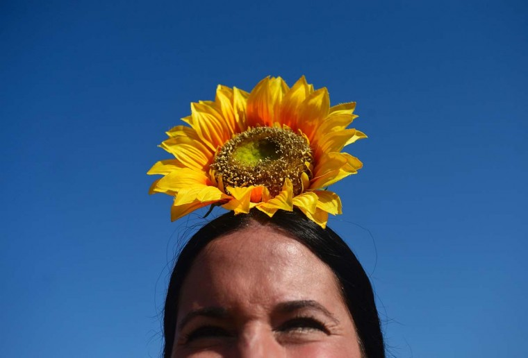 A pilgrim sporting a sunflower looks on as she crosses the Quema river during the annual El Rocio pilgrimage in Villamanrique, near Sevilla on June 1, 2017. (CRISTINA QUICLER/AFP/Getty Images)