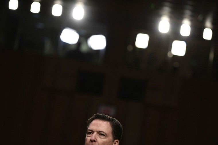 Former FBI director James Comey speaks during a hearing before the Senate Select Committee on Intelligence on Capitol Hill June 8, 2017 in Washington, DC.Fired FBI director James Comey took the stand Thursday in a crucial Senate hearing, repeating explosive allegations that President Donald Trump badgered him over the highly sensitive investigation Russia's meddling in the 2016 election. / (AFP Photo/Brendan Smialowski)