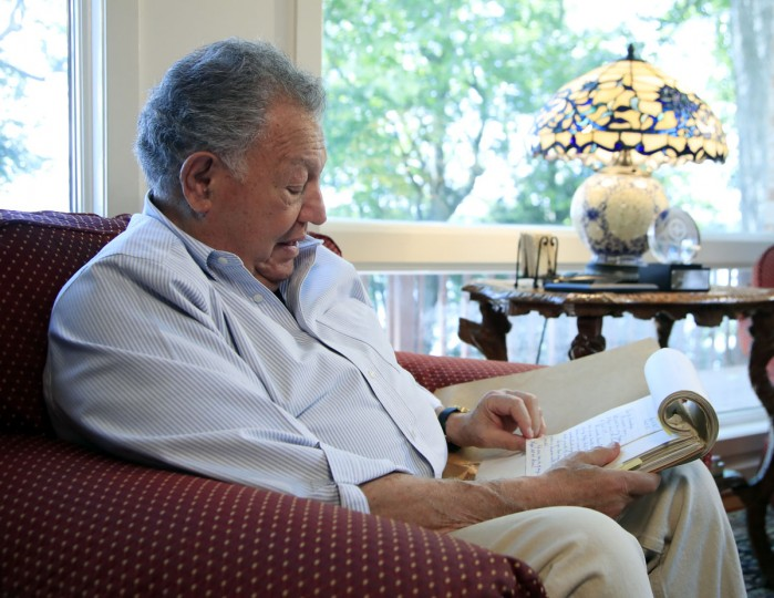 Phil Hirschkop, one of the two attorneys who defended the Loving case, reads a letter from Mildred and Richard Loving, at his home in Lorton, Va., Wednesday, June 7, 2017. Fifty years after Mildred and Richard Loving's landmark legal challenge shattered the laws against interracial marriage in the U.S., some couples of different races still talk of facing discrimination, disapproval and sometimes outright hostility from their fellow Americans. (AP Photo/Manuel Balce Ceneta)