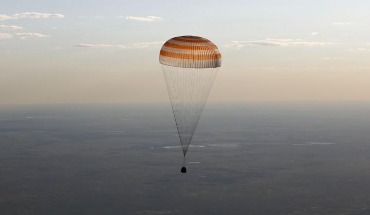 A Russian Soyuz capsule carrying two astronauts after a half-year aboard the International Space Station descends beneath a parachute just before landing in a remote area outside the town of Dzhezkazgan, Kazakhstan, Friday, June 2, 2017. The capsule with the International Space Station (ISS) crew of Russian cosmonaut Oleg Novitsky and French astronaut Thomas Pesquet, landed Friday on the steppes of Kazakhstan. (Shamil Zhumatov/Pool Photo via AP)