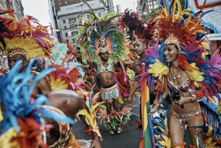 Members of the Caribbean pride pause during the New York City Pride Parade on Sunday, June 25, 2017, in New York. (AP Photo/Andres Kudacki)