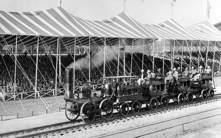 October 2, 1927-THE FAIR OF THE IRON HORSE UNDER WAY--IN PAGEANT OF TRANSPORTATION--Drawing It's Three Imlay Coaches, this ancient locomotive is one of the series that depicts railroading from its earliest days to the present. (Baltimore Sun archives)