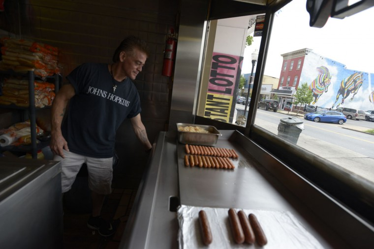 """It's always been a good neighborhood,"" Andy Farrantos, owner of G&A Restaurant, said of Highlandtown. ""I say that with a big smile on my face."" His restaurant's famous ""Coney Island hot dog"" – a frankfurter topped with hamburger and raw onions – has been featured on the Food Network. (Christina Tkacik/Baltimore Sun)"