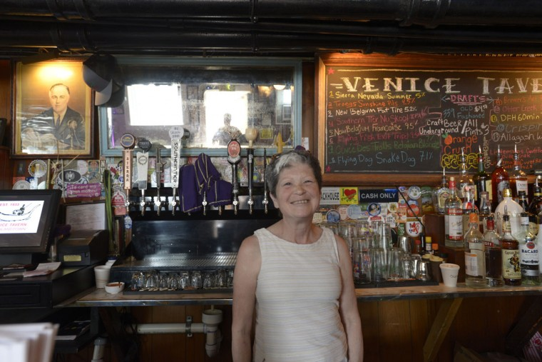 "A portrait of FDR still hangs at the Venice Tavern. He was president when it opened in the 1930s. Mari Wick, a bartender there, said she likes the convenience of the neighborhood and the sense of community. ""And we're all regulars. Everybody here are regulars."" (Christina Tkacik/Baltimore Sun)"
