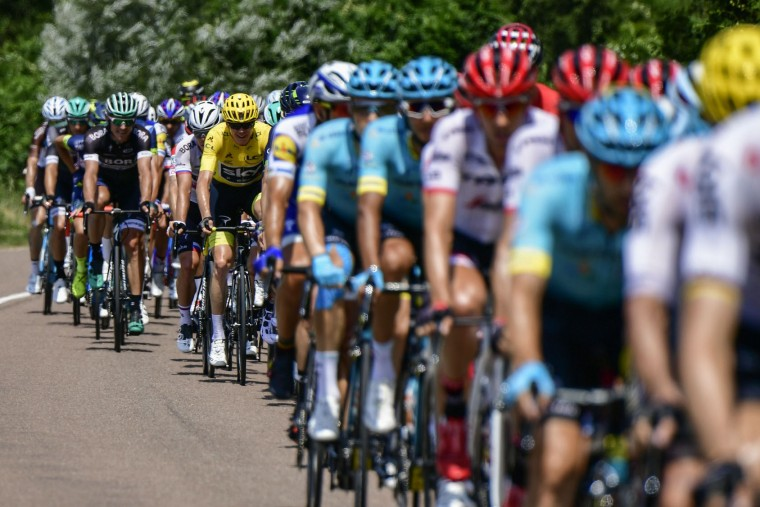 Great Britain's Christopher Froome (C-L), wearing the overall leader's yellow jersey, rides in the pack during the 213,5 km seventh stage of the 104th edition of the Tour de France cycling race on July 7, 2017 between Troyes and Nuits-Saint-Georges. (Philippe Lopez/AFP/Getty Images)