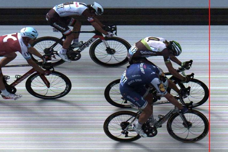 A handout picture released by ASO shows Germany's Marcel Kittel (R-bottom) crossing the finish line ahead of Norway's Edvald Boasson Hagen (R-top) at the end of the 213,5 km seventh stage of the 104th edition of the Tour de France cycling race on July 7, 2017 between Troyes and Nuits-Saint-Georges. (ASO / Handout/Getty Images)