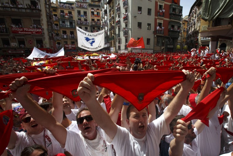 Revellers hold up their red handkerchiefs as they enjoy the atmosphere during the opening day or 'Chupinazo' of the San Fermin Running of the Bulls fiesta on July 6, 2017 in Pamplona, Spain. The annual Fiesta de San Fermin, made famous by the 1926 novel of US writer Ernest Hemingway entitled 'The Sun Also Rises', involves the daily running of the bulls through the historic heart of Pamplona to the bull ring. (Photo by Pablo Blazquez Dominguez/Getty Images)