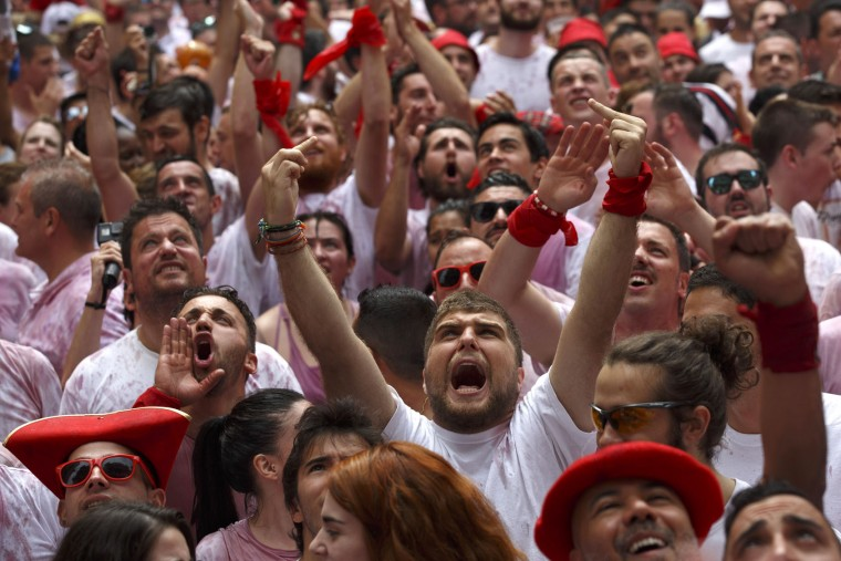 Some revellers complain as a worker of Pamplona's Town Hall places the 'Ikurrina' (Basque flag) at the balcony during the opening day or 'Chupinazo' of the San Fermin Running of the Bulls fiesta on July 6, 2017 in Pamplona, Spain. The annual Fiesta de San Fermin, made famous by the 1926 novel of US writer Ernest Hemingway entitled 'The Sun Also Rises', involves the daily running of the bulls through the historic heart of Pamplona to the bull ring. (Photo by Pablo Blazquez Dominguez/Getty Images)