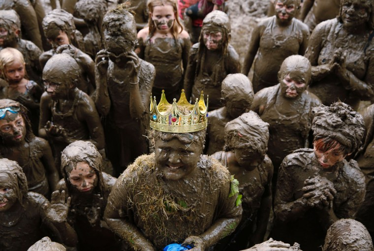Brian Wilson, 10 of Redford smiles after being crowned Mud Day King at Wayne County's annual Mud Day at Nankin Mills Park on July 11, 2017 in Westland, Michigan. The mud pit contains 200 tons (181 metric tons) of top soil and 20,000 gallons (75,708 liters) of water. (Jeff Kowalsky/AFP/Getty Images)