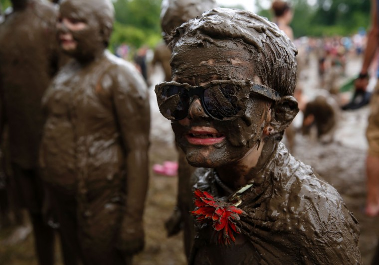 A.J. Glander of Westland, Michigan waits for the Mud Day King judging during Wayne County's annual Mud Day at Nankin Mills Park on July 11, 2017 in Westland, Michigan. The mud pit contains 200 tons (181 metric tons) of top soil and 20,000 gallons (75,708 liters) of water. (Jeff Kowalsky/AFP/Getty Images)
