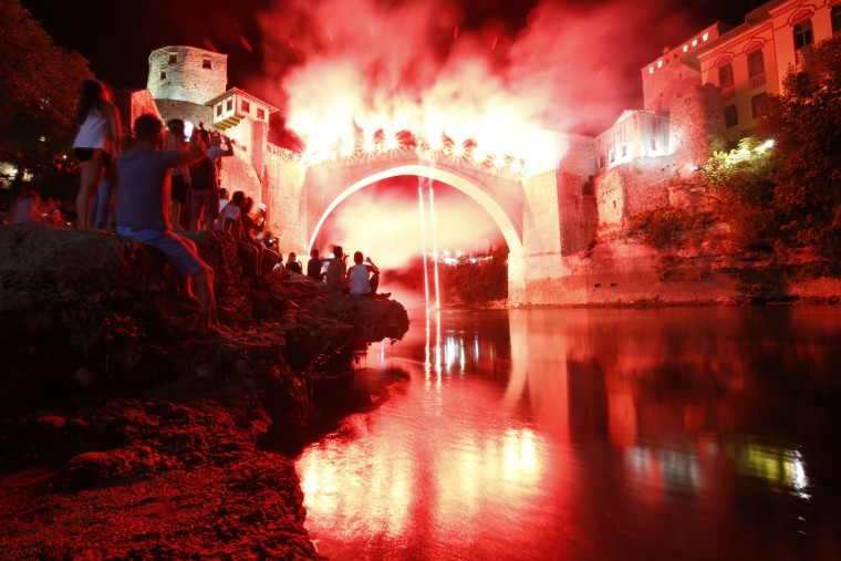 A Bosnian jumper, launches himself while holding burning torches, during traditional night jump from the Old Mostar Bridge, in Mostar, 140 kms south of Bosnian capital of Sarajevo, Sunday, July 30, 2017. A total of 41 divers from Bosnia and neighbouring countries competed diving from the 25 meter (82 feet) high Old Mostar Bridge into the Neretva River. (AP Photo/Amel Emric)
