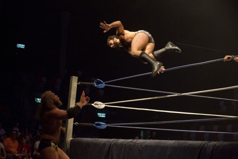 Wrestler David Starr jumps towards Juran Simmons during The Rage Wrestling Mega Show in Tel Aviv, Israel, Sunday, July 9, 2017. The Israeli Wrestling League hosted a wrestling show in Tel Aviv with Kevin Von Erich and some of the WWE greatest of all time. (AP Photo/Ariel Schalit)