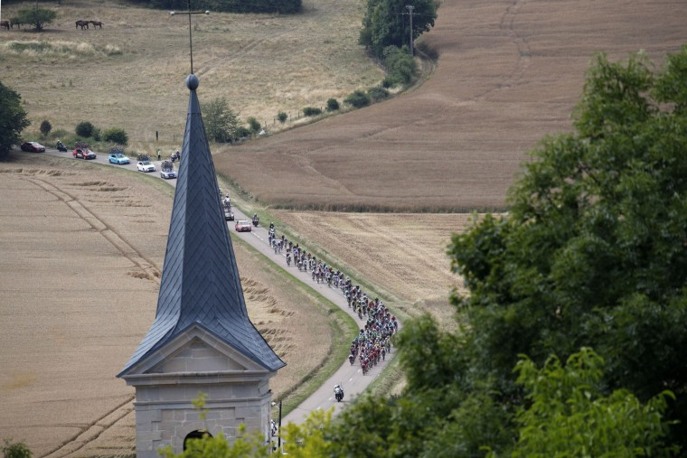 The pack rides during the seventh stage of the Tour de France cycling race over 213.5 kilometers (132.7 miles) with start in Troyes and finish in Nuits-Saint-Georges, France, Friday, July 7, 2017. (AP Photo/Christophe Ena)