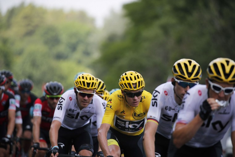 Britain's Chris Froome, wearing the overall leader's yellow jersey, rides with his teammates during the seventh stage of the Tour de France cycling race over 213.5 kilometers (132.7 miles) with start in Troyes and finish in Nuits-Saint-Georges, France, Friday, July 7, 2017. (AP Photo/Christophe Ena)