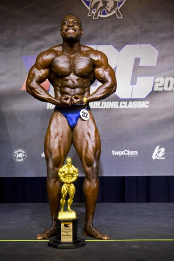 "In this July 23, 2017 photo, Haitian bodybuilder Spely Laventure poses with his trophy after winning the Haiti Bodybuilding Classic, an event with Haitian and Dominican Republican athletes, in Port-au-Prince, Haiti. Laventure wants to become Haiti's first professional bodybuilder and dreams about participating in Mr. Olympia, the world's biggest bodybuilding competition. ""I know it's going to be very hard ... In Haiti especially, it's not easy,"" he said, adding that he believes he'll make it: ""I was a skinny guy, but look at me right now."" (AP Photo/Dieu Nalio Chery)"