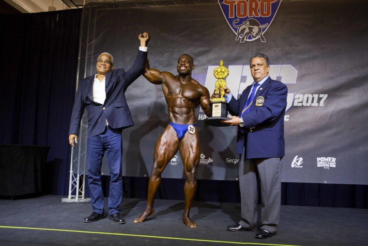 "In this July 23, 2017 photo, Haitian bodybuilder Spely Laventure stands between Tony Pena, president of the Dominican Rep. federation of bodybuilding, right, and Fritz Gerald Fung, president of the Haitian federation of bodybuilding, after winning Haiti Bodybuilding Classic, an event with Haitian and Dominican Republican athletes, in Port-au-Prince, Haiti. Laventure wants to become Haiti's first professional bodybuilder and dreams about participating in Mr. Olympia, the world's biggest bodybuilding competition. ""I know it's going to be very hard ... In Haiti especially, it's not easy,"" he said, adding that he believes he'll make it: ""I was a skinny guy, but look at me right now."" (AP Photo/Dieu Nalio Chery)"