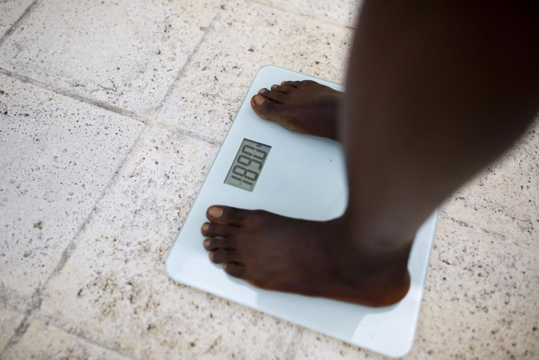 "In this July 23, 2017 photo, Haitian bodybuilder Spely Laventure gets weighed before a bodybuilding competition between Haiti and Dominican Republic in Port-au-Prince, Haiti. ""Most of the things that you eat to prepare for competition, they import it,"" Laventure said. (AP Photo/Dieu Nalio Chery)"