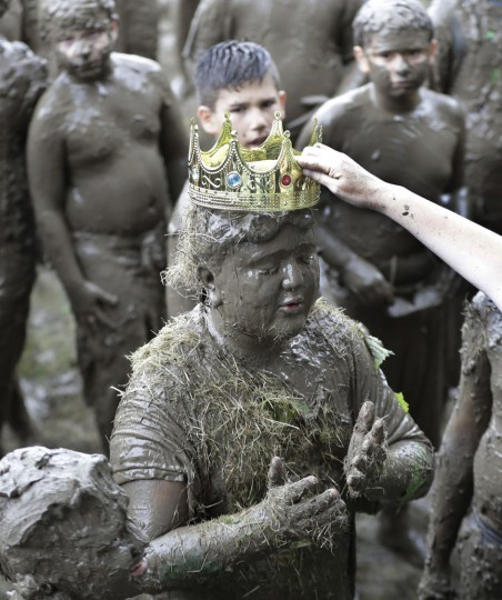 Brian Wilson, 10, is crowned 2017 King of Mud Day at the Nankin Mills Park, Tuesday, July 11, 2017 in Westland, Mich. The annual day sponsored by the Wayne County Parks takes place in a 75' x 150' giant mud pit that gives children the opportunity to get down and dirty at one of the messiest playgrounds Southeast Michigan has ever seen. (AP Photo/Carlos Osorio)